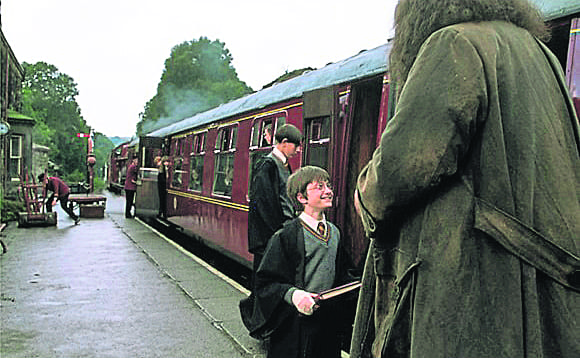 A young Harry Potter (Daniel Radcliffe) filming a scene in the first Harry Potter movie.