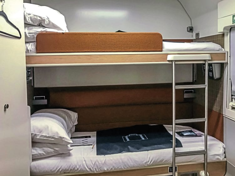 Club Twin cabin with two beds set up. These cabins also feature an en suite wet room with shower and toilet.