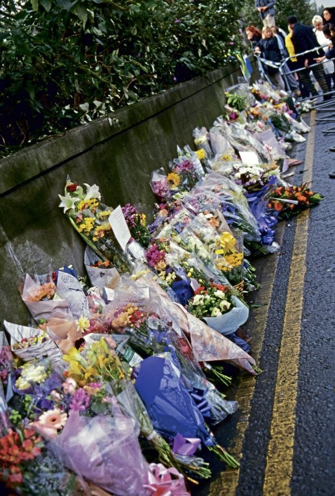 """Floral tributes near the crash site. One tribute left in memory of HST driver Brian Cooper said: """"For dear Brian, the iron road""""."""